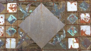 An art installation featuring multicoloured metal squares and diamonds.